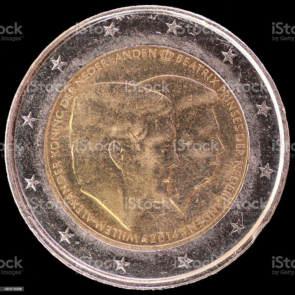 Commemorative two euro coin  featuring Queen Beatrix portrait , Netherlands 2014 stock photo