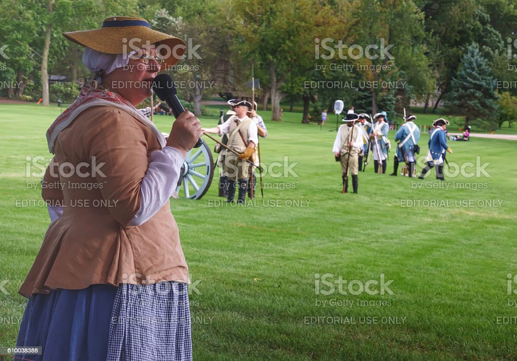 Commentator in period dress at suburban war reenactment stock photo