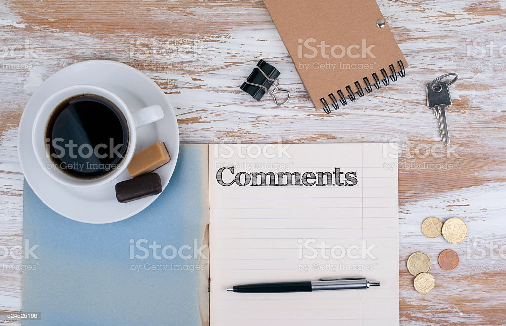Comments - Copybook on the desktop. stock photo