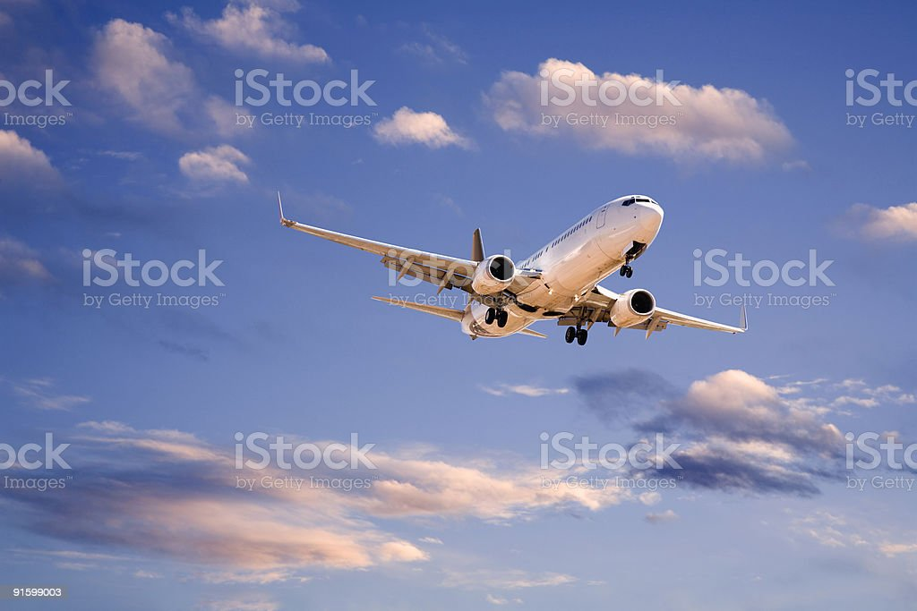 Commercial Aircraft in Evening Sky royalty-free stock photo