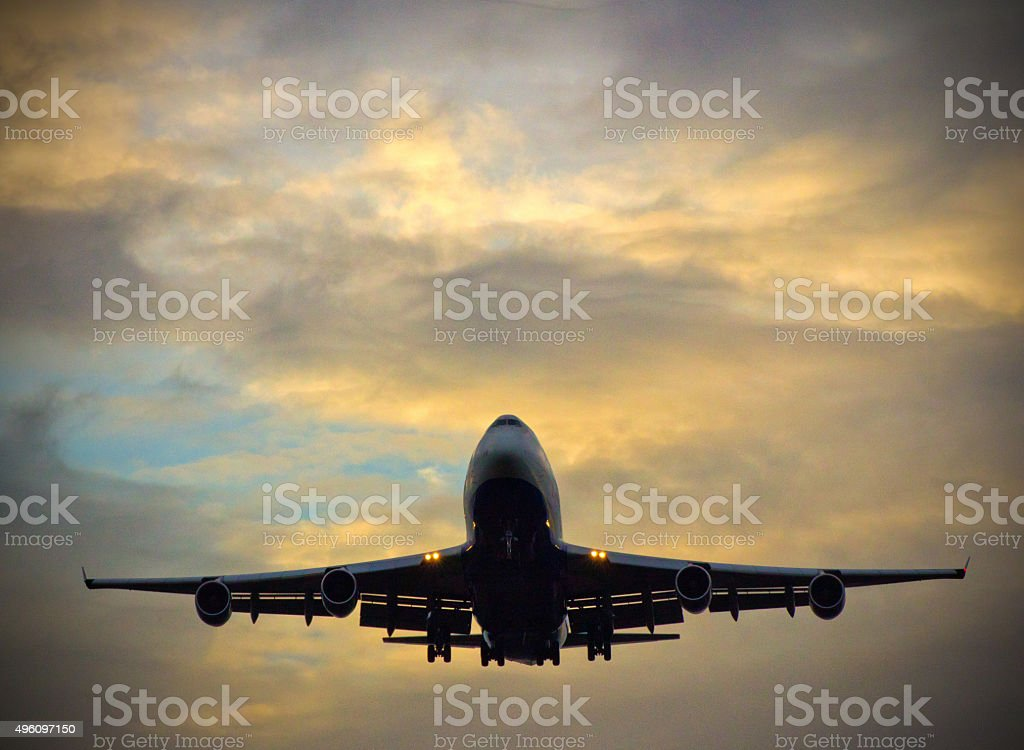 Commercial Aircraft Landing at dusk stock photo