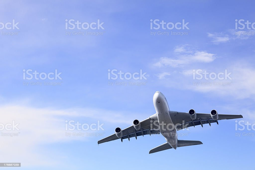Commercial Aircraft Taking off into Bright Summer Sky Superjumbo stock photo