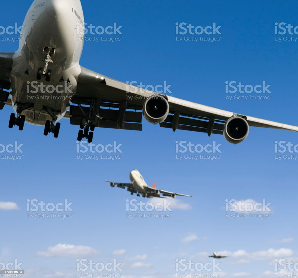Commercial airlines mid flight against a bright blue sky. royalty-free stock photo