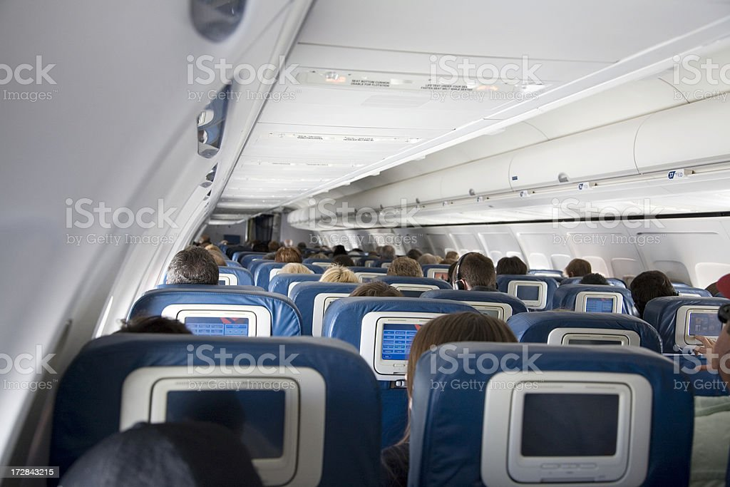 Commercial Airplane Cabin Full of Passengers stock photo