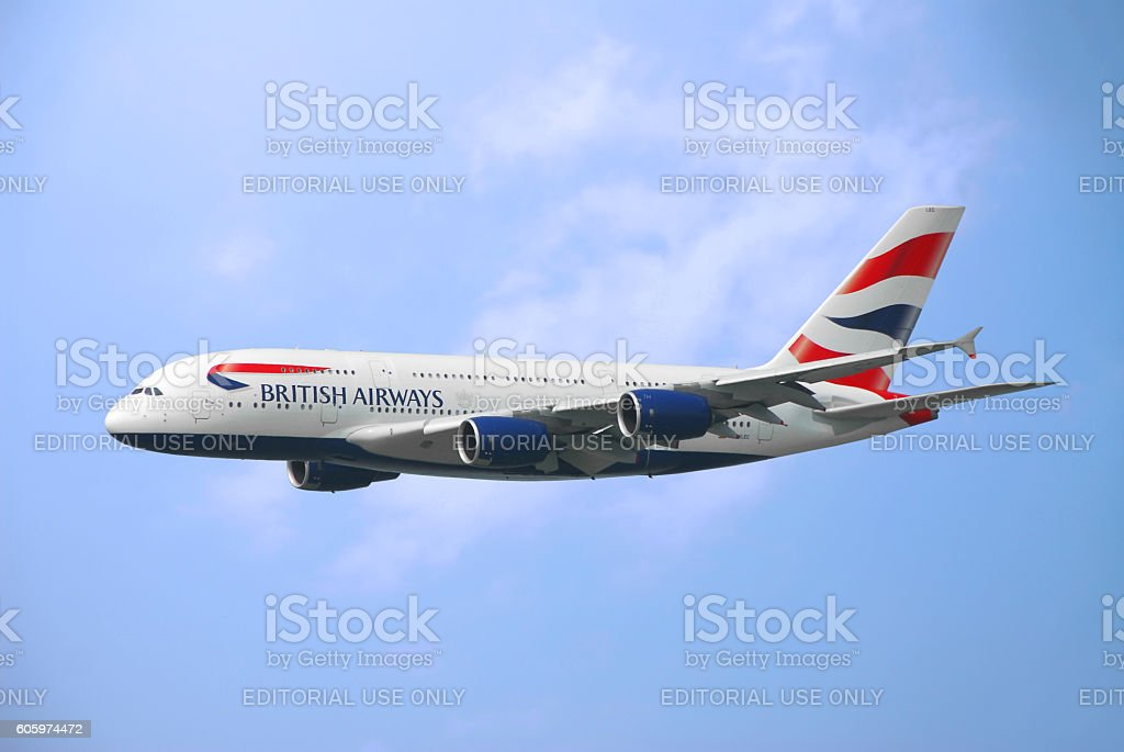 Commercial Airplane flying in the sky stock photo