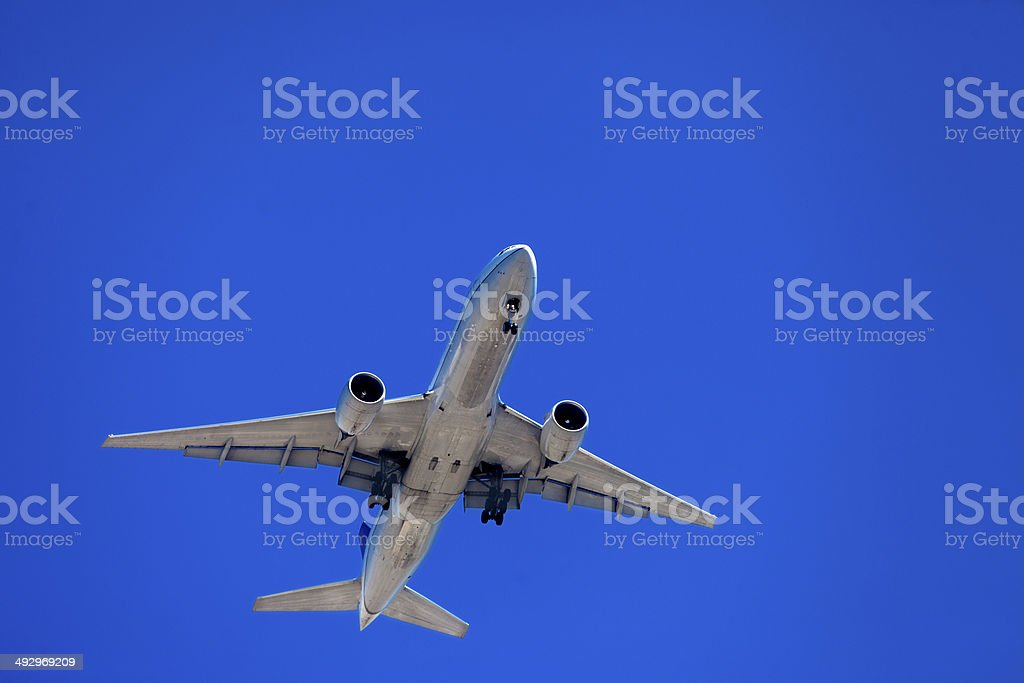 Commercial airplane flying royalty-free stock photo