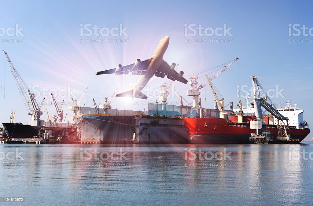 commercial airplane is flying above the tanker stock photo
