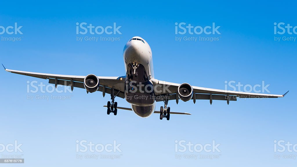 Commercial airplane landing stock photo