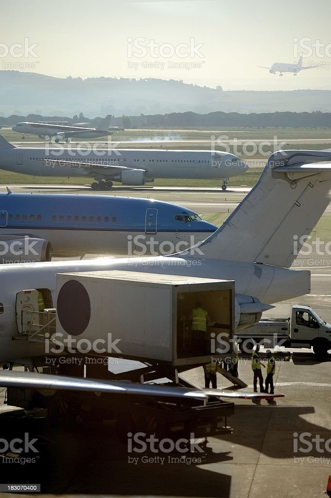 Commercial airplane loading in the airport royalty-free stock photo
