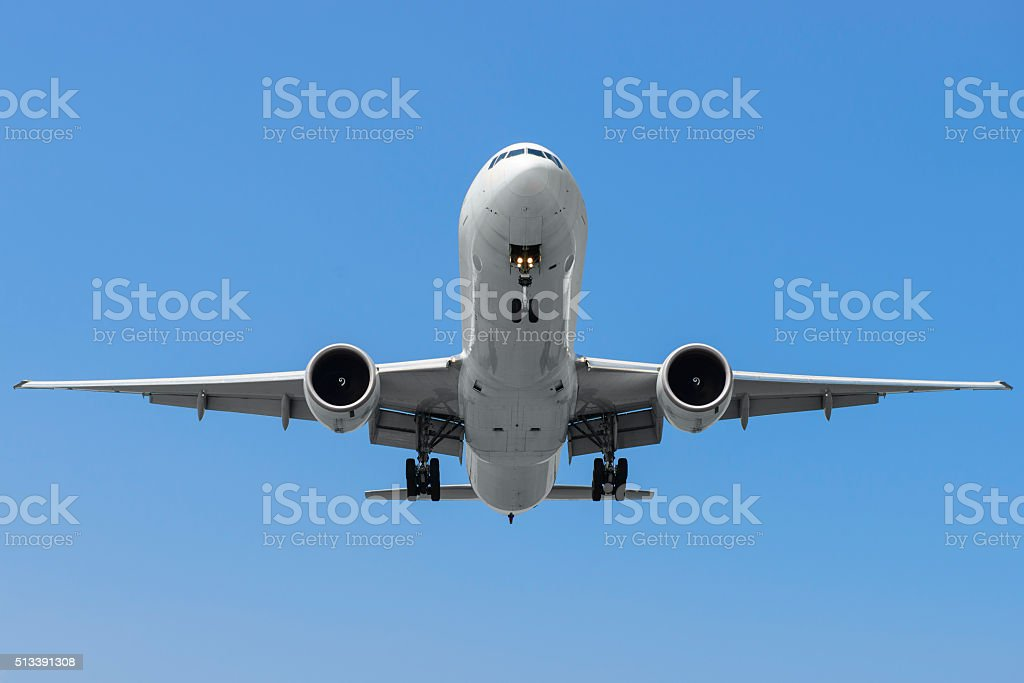 Commercial airplane on finals runway stock photo