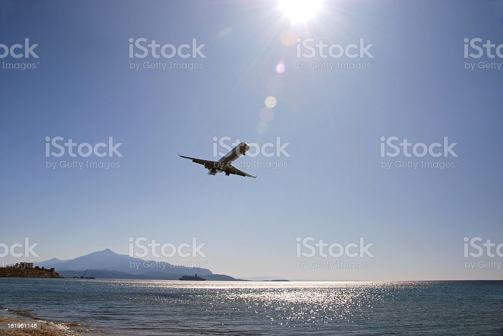 Commercial Airplane takeoff frome the Island of Samos. royalty-free stock photo