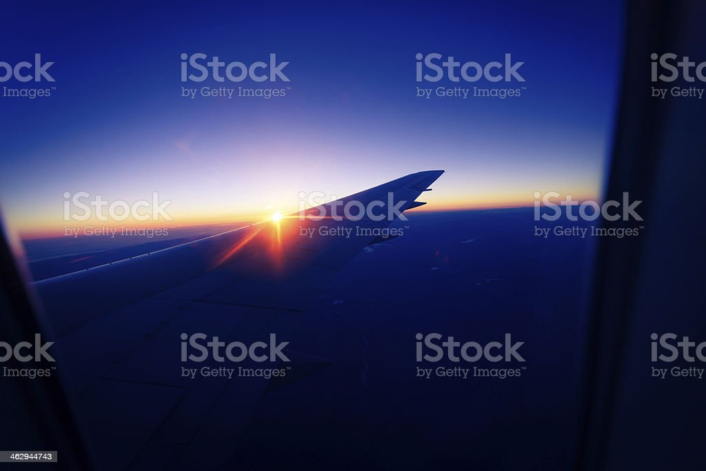 Commercial Airplane Wing at Sunrise royalty-free stock photo