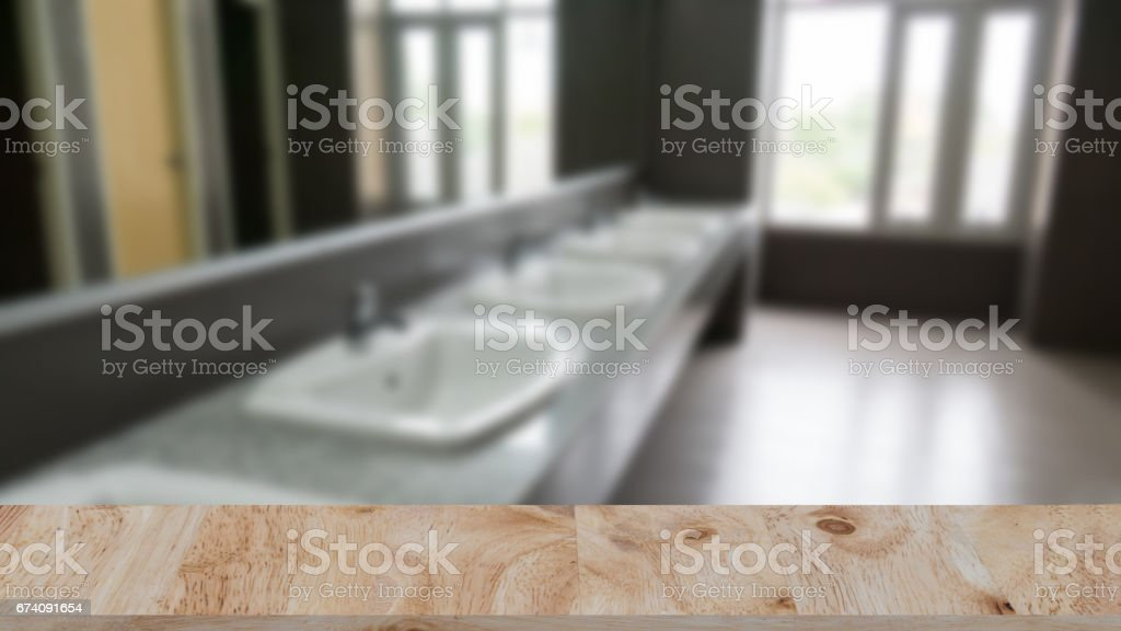 Commercial bathroom for washing hands. washbasins public toilets with wood table for montage or display your product stock photo
