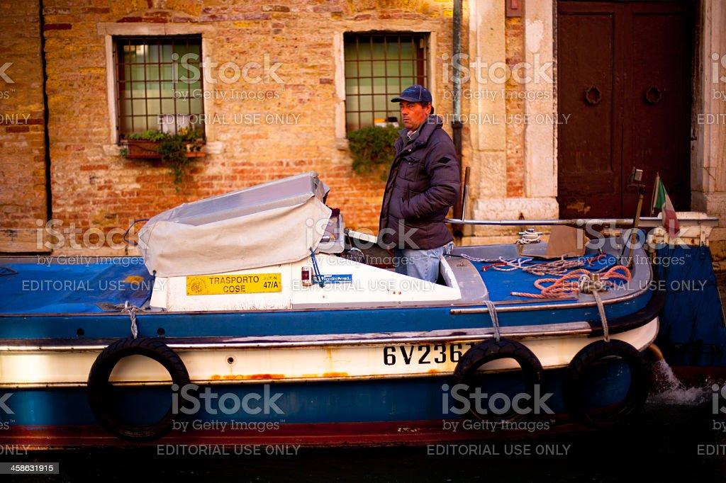 Commercial Boat Pilot, Venice, Italy royalty-free stock photo