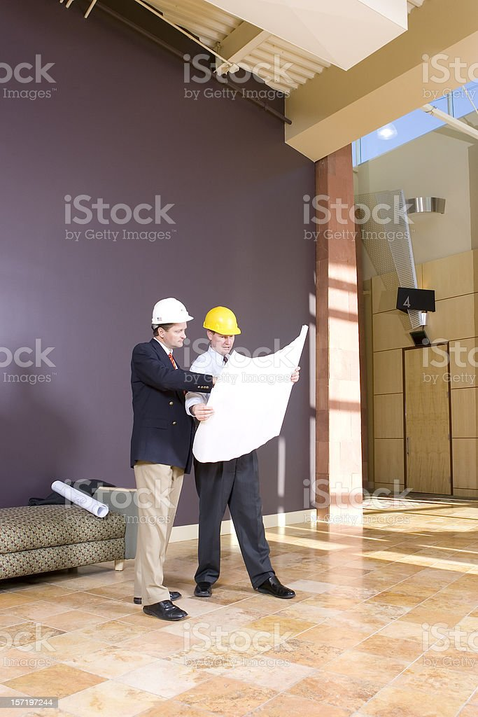 Commercial Building Planners with Blueprints royalty-free stock photo