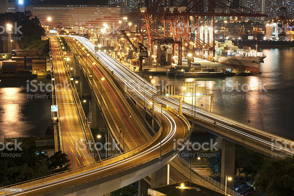 Commercial container port and highway royalty-free stock photo