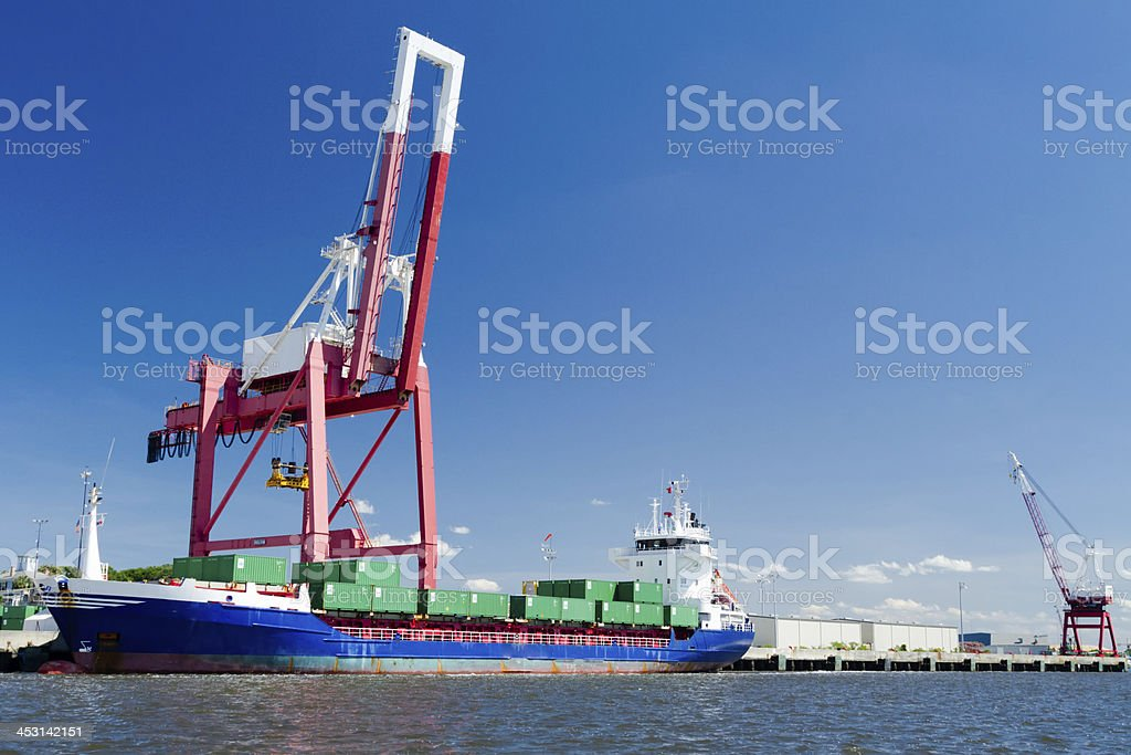 Commercial container ship in port. stock photo