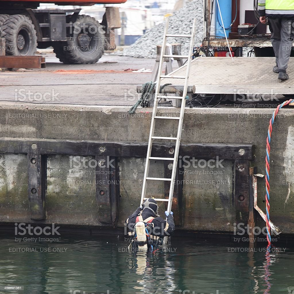 Commercial Diver Entering Water stock photo