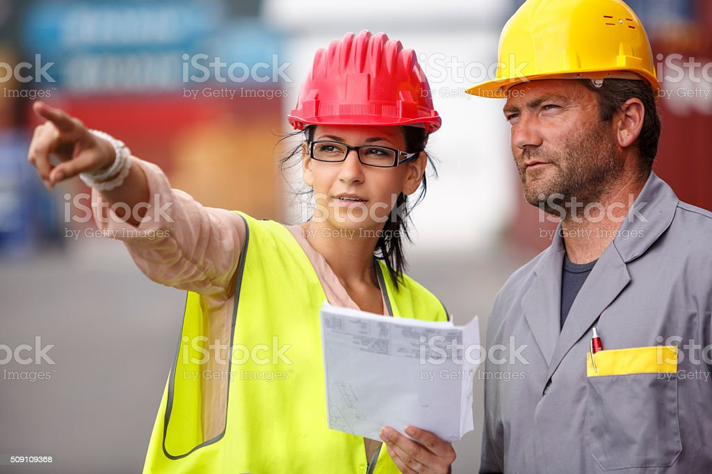 Commercial docks worker and inspector at commercial dock stock photo