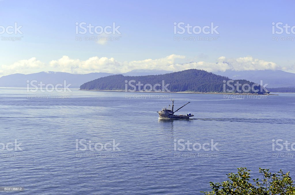 Commercial fishing boat in the ocean stock photo