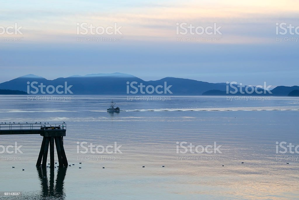 Commercial Fishing Boat Returning to Harbor royalty-free stock photo