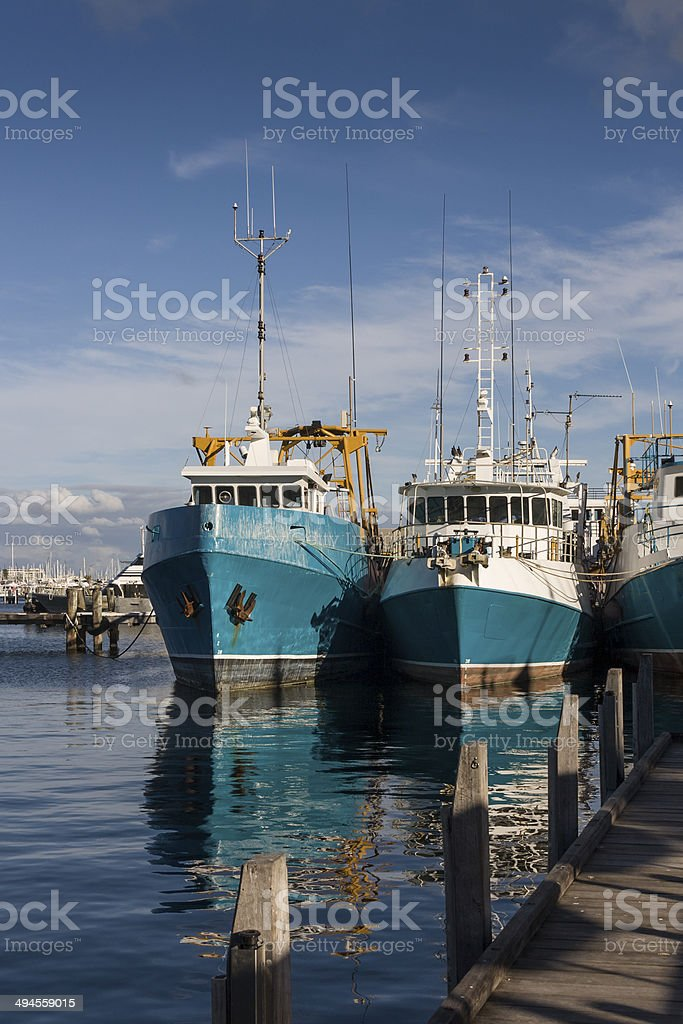 Commercial fishing boats in Fremantle harbour south of Perth stock photo