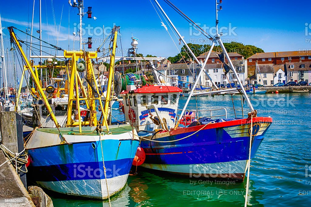 Commercial Fishing boats in Weymouth harbour, UK stock photo
