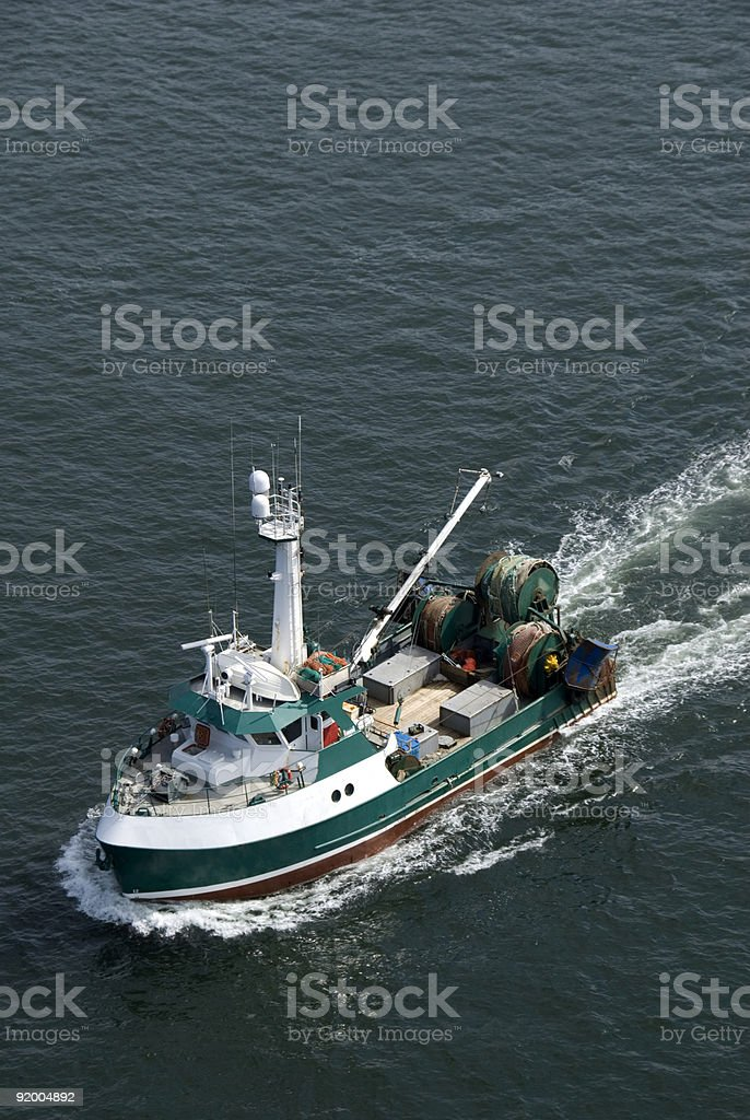 Commercial fishing trawler in Ocean royalty-free stock photo