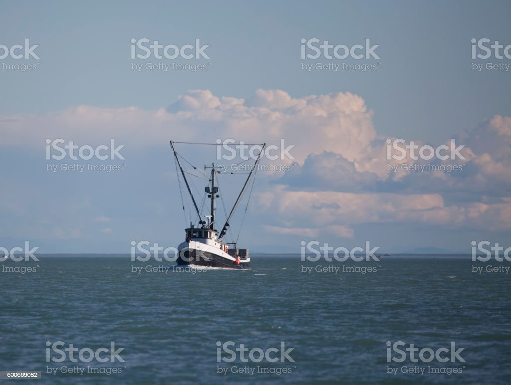 Commercial fishing trawler in Southeast Alaska stock photo