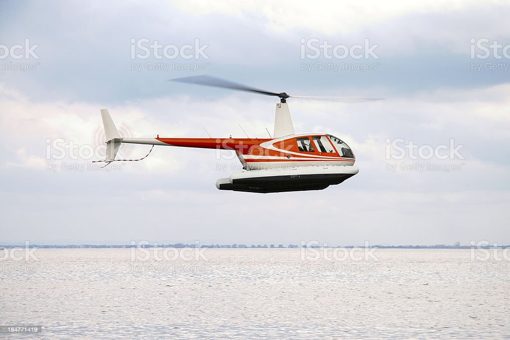 commercial helicopter flying in the sky royalty-free stock photo