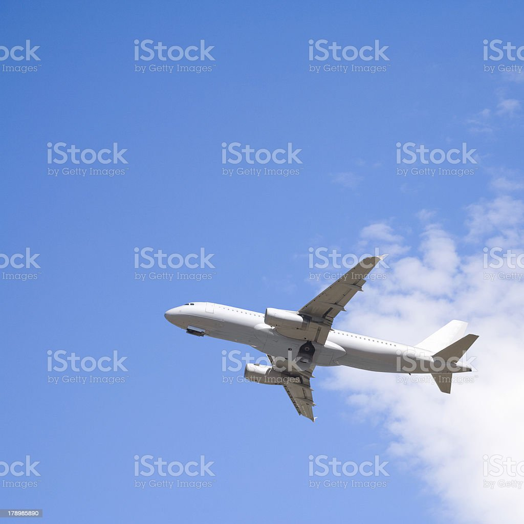 Commercial Jet In Blue Summer Sky royalty-free stock photo