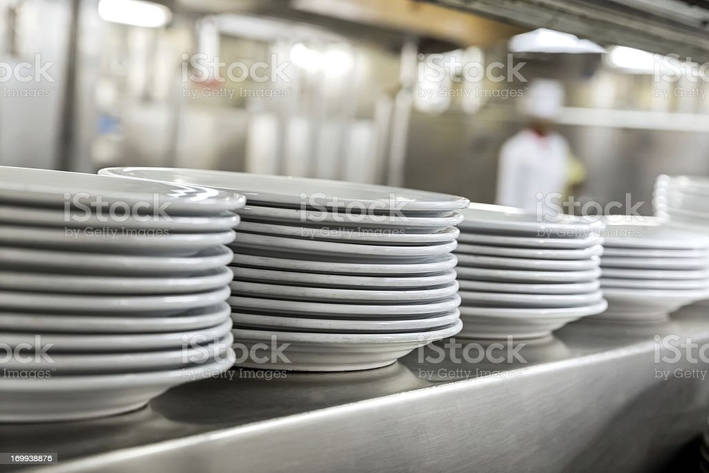 Commercial kitchen showing dishes stock photo