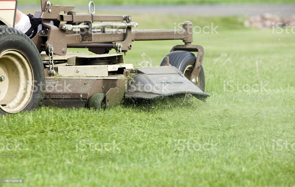 Commercial Lawn Mower Discharging Grass stock photo