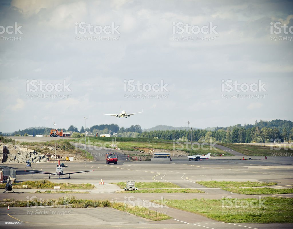 commercial passenger Jet airplane touch down - Norway royalty-free stock photo