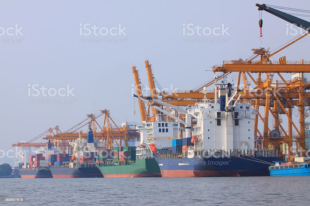 commercial ship loading container in port stock photo