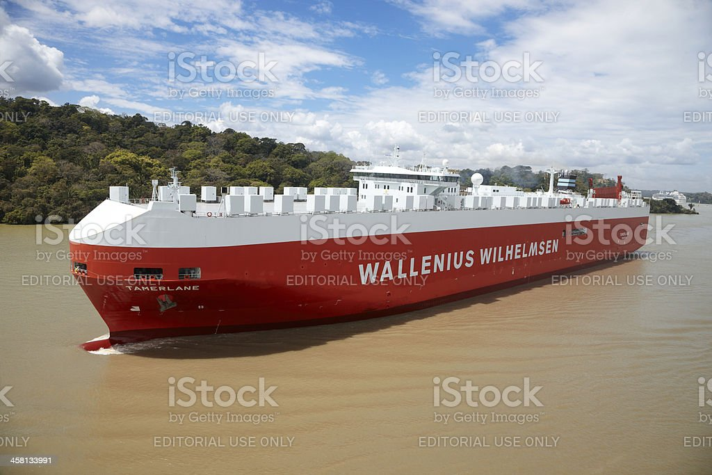 Commercial Ship Navigates a Turn in Panama Canal royalty-free stock photo