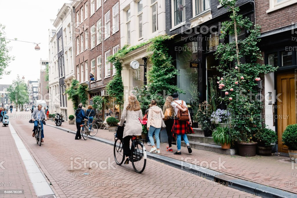Commercial street in historical city center of Amsterdam. stock photo