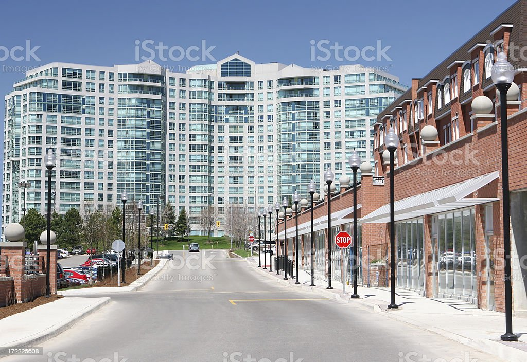 Commercial street near a large Apartment Building stock photo