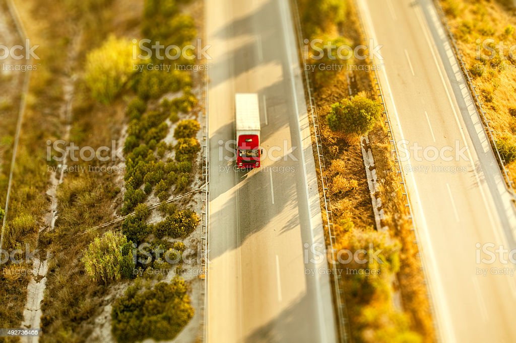 Commercial truck moving on highway - aerial view stock photo