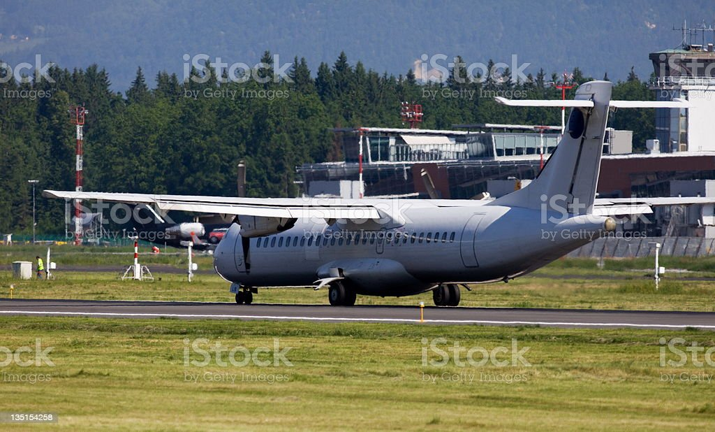 Commercial turboprop airplane landing royalty-free stock photo