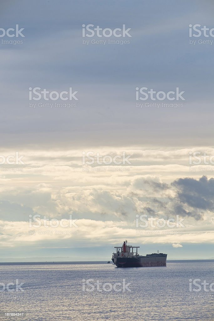 Commerical Cargo Ship  Anchored in Vancouver's English Bay at Sunset royalty-free stock photo