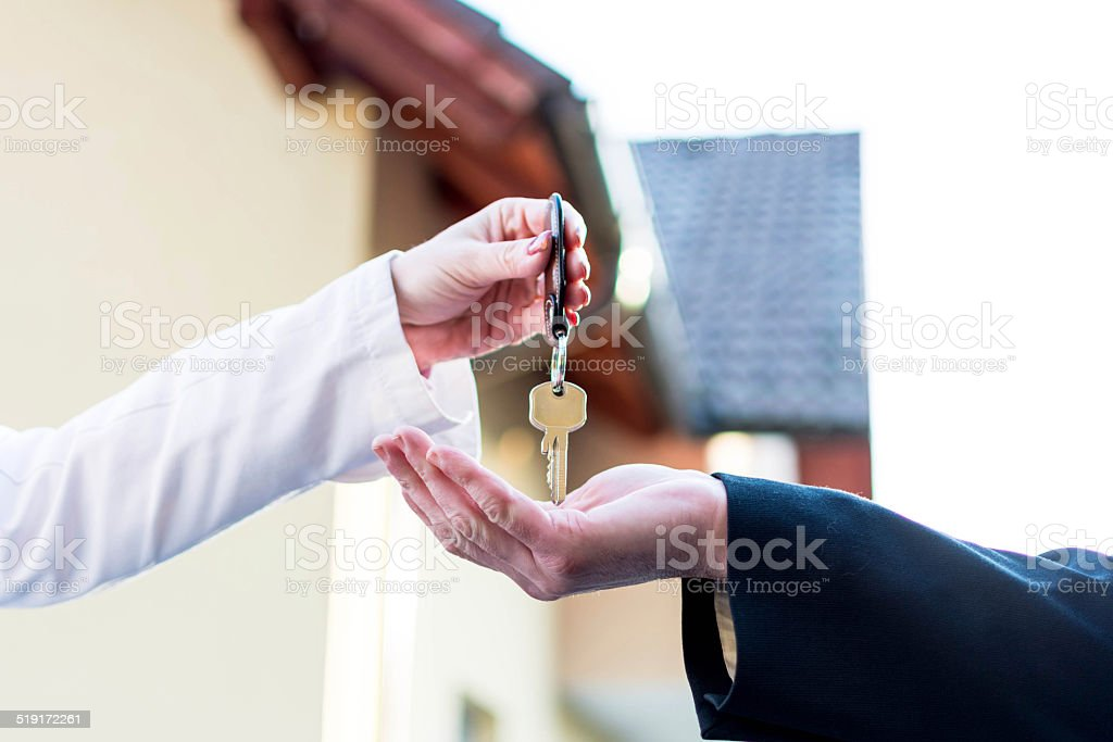 Commitment key to new house stock photo