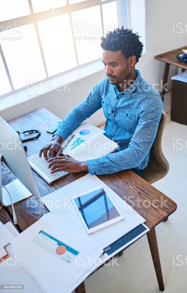Committed to completed his work tasks stock photo