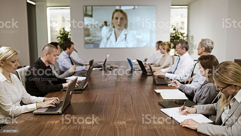 Committee Having a Video Conference in the Boardroom stock photo