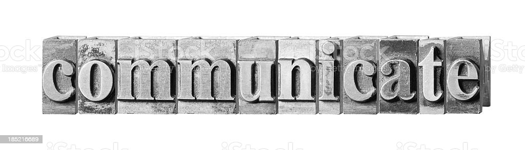 Communicate written in metal printers block letters royalty-free stock photo