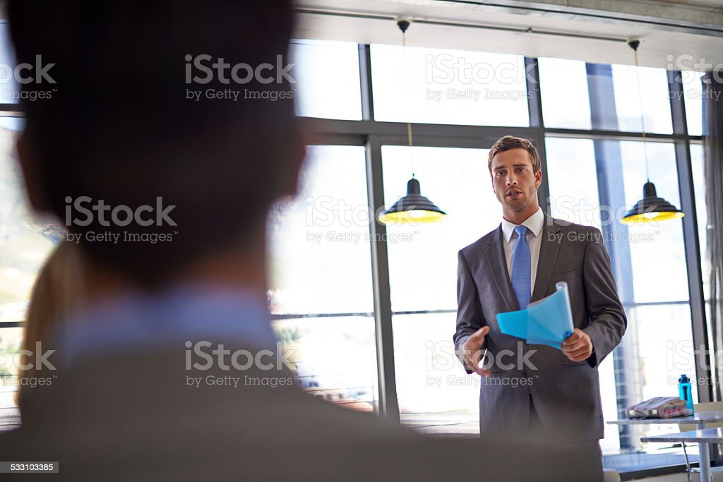 Communicating his ideas to the rest of the team stock photo
