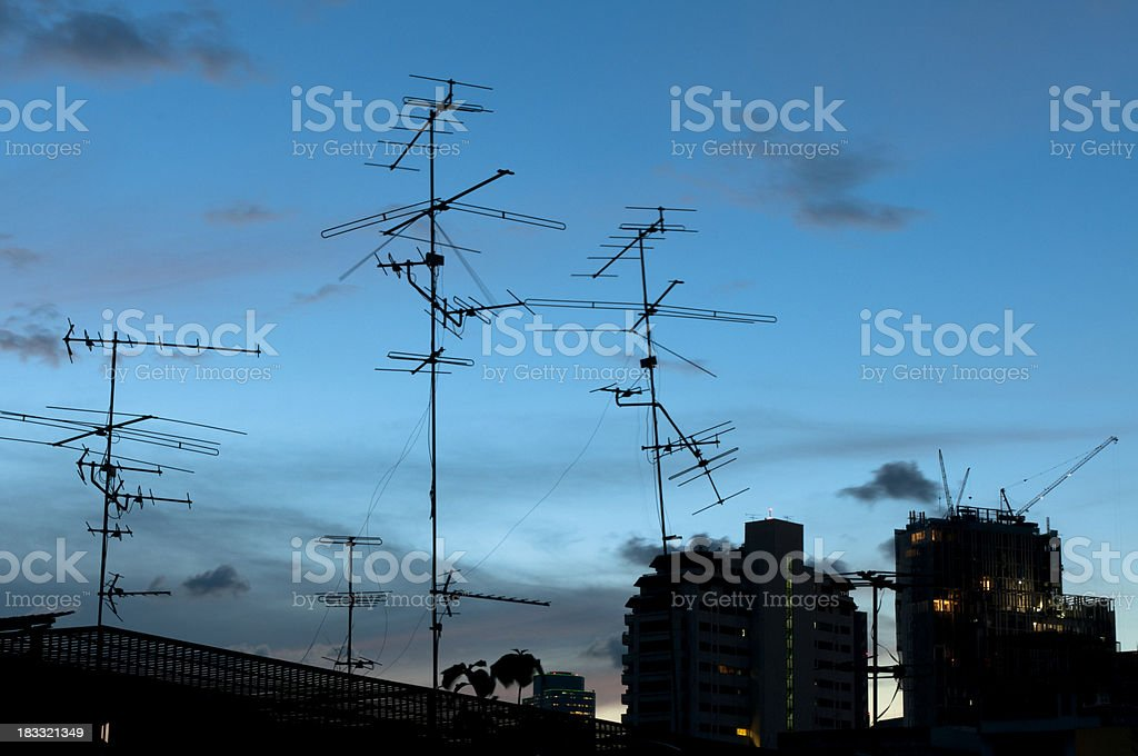 Communication Antennas Against The Evening Sky royalty-free stock photo