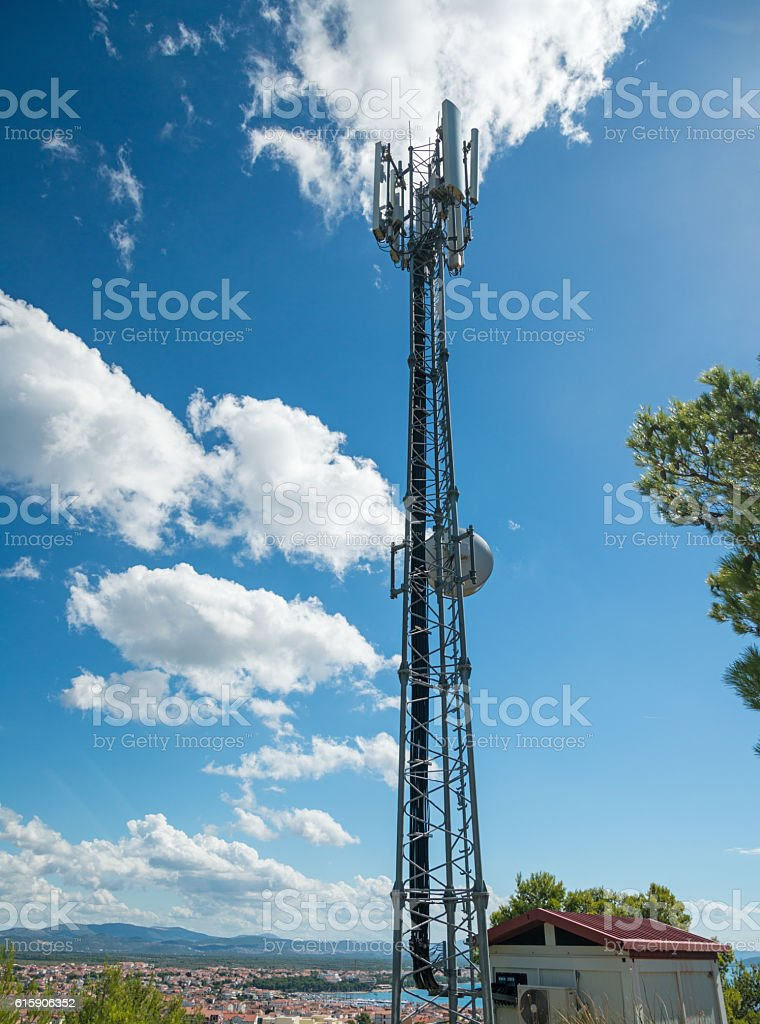 Communication cell mast stock photo