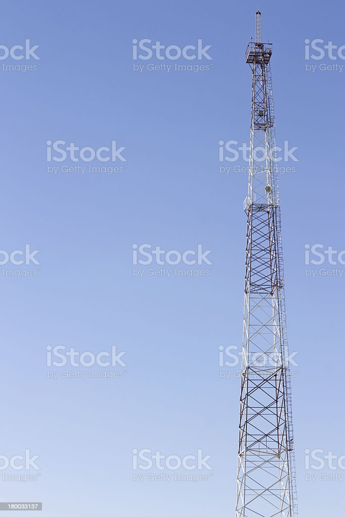 Communication cellular tower on blue sky royalty-free stock photo