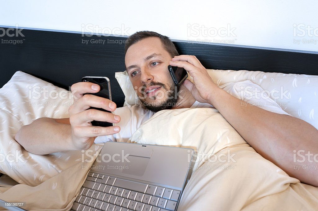 Communication from the bed royalty-free stock photo